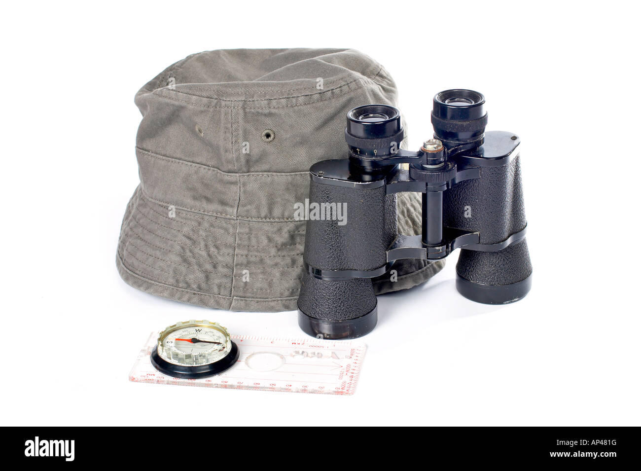 Hat compass and binoculars on a white background - Stock Image
