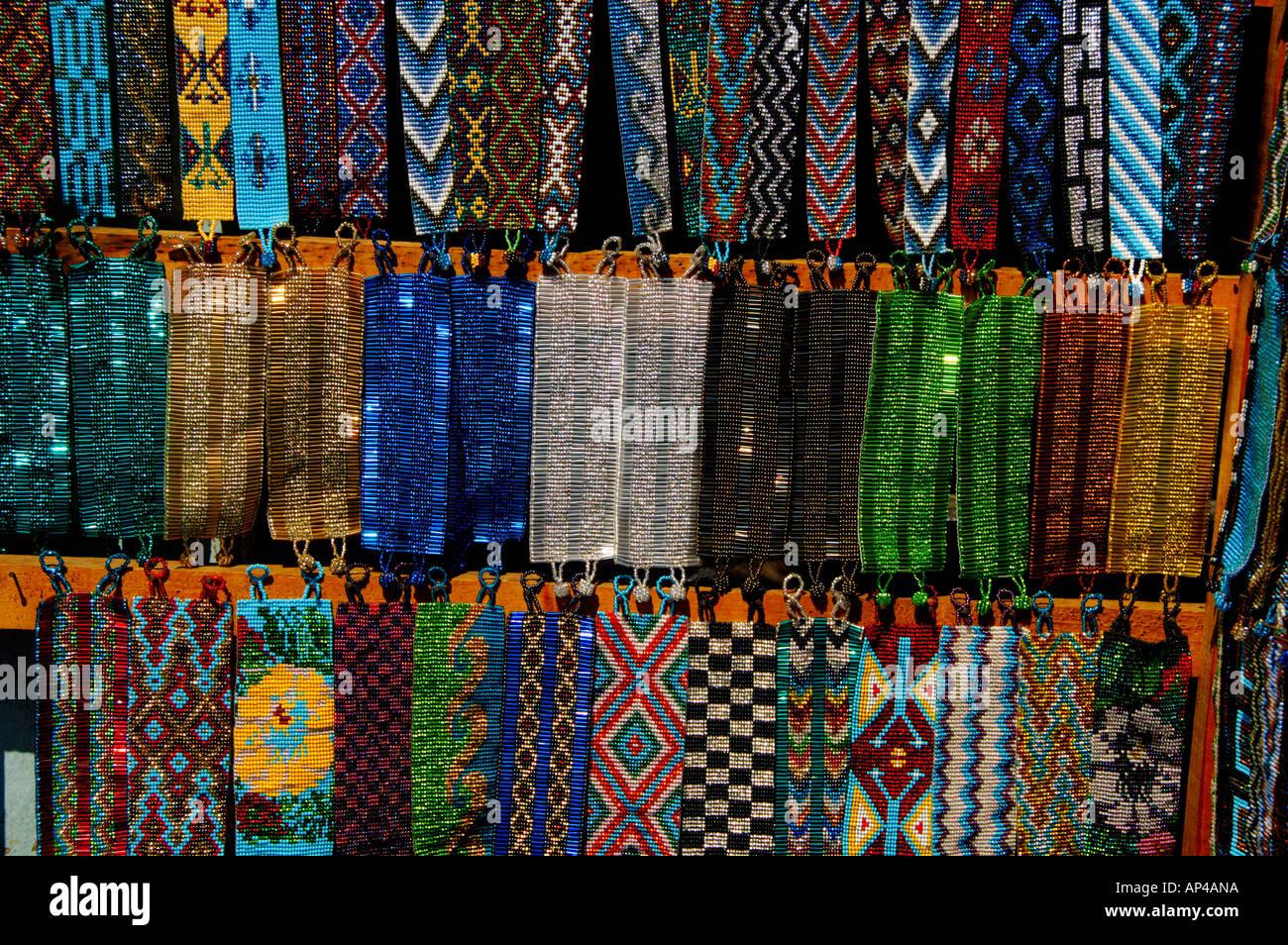 Central America, Guatemala, Western Highlands, Lake Atitlan, Santiago Atitlan. Colorful beadwork for sale. - Stock Image