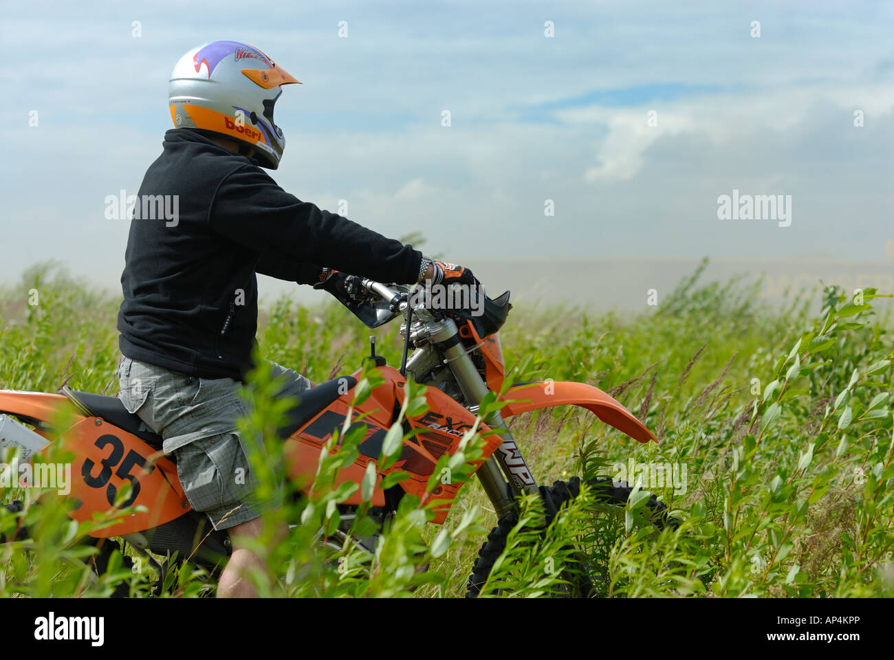 Motorbiker on a KTM motorcycle watching the Rallye Dresden Breslau 2007 - Stock Image