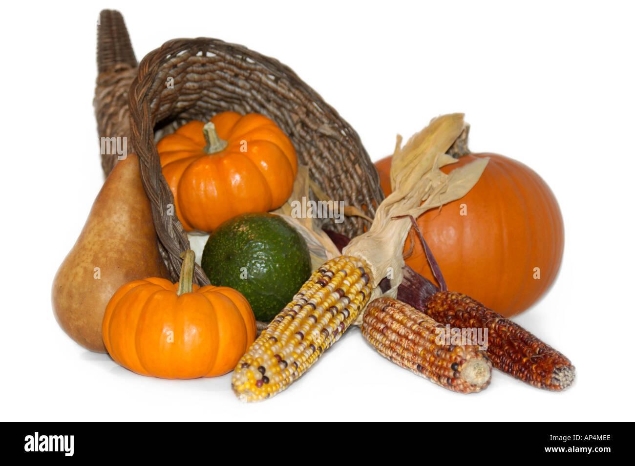 Thanksgiving harvest scene with cornucopia isolated against white background - Stock Image