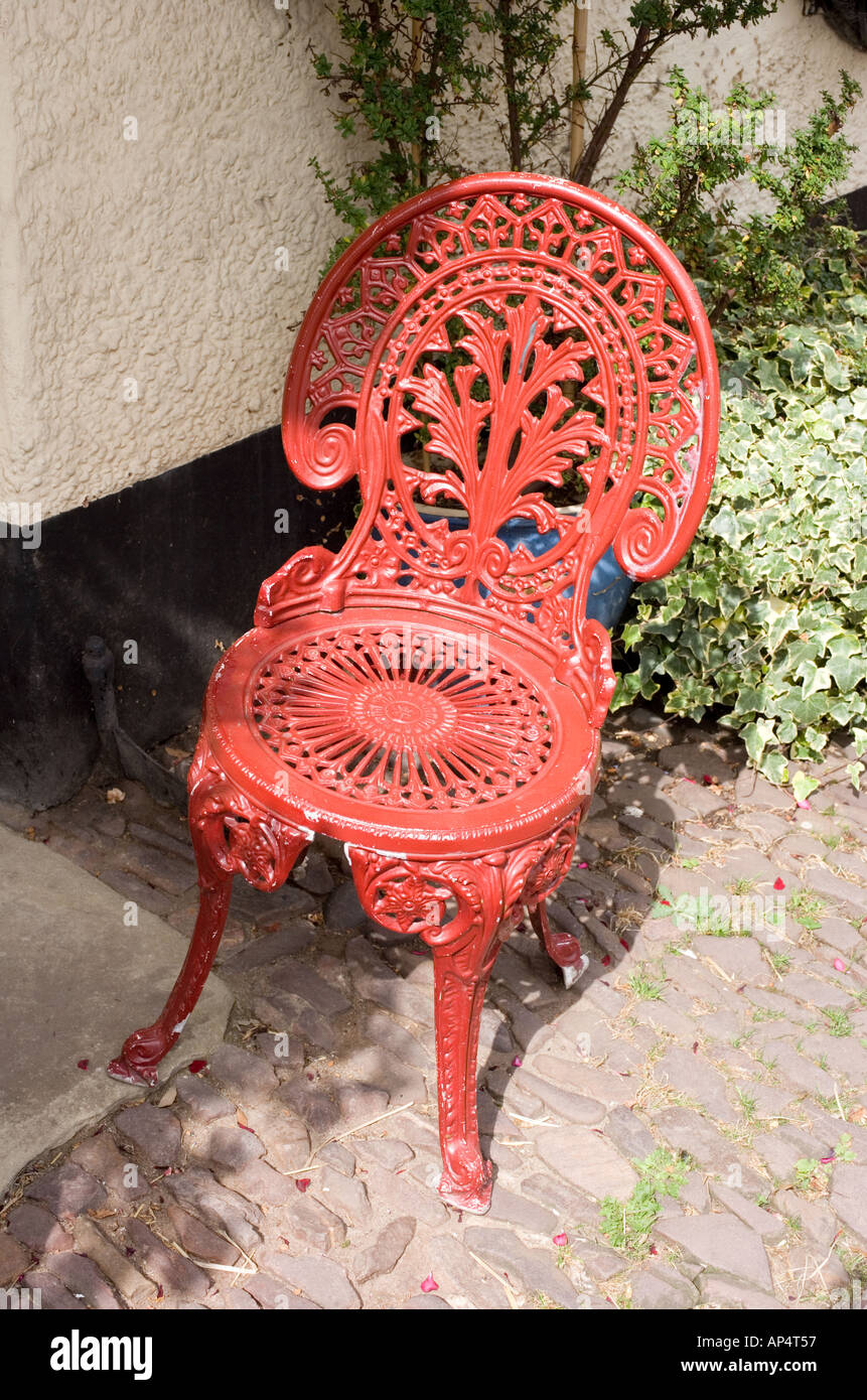 Groovy Red Painted Wrought Iron Chair Outside Restaurant At Dunster Machost Co Dining Chair Design Ideas Machostcouk