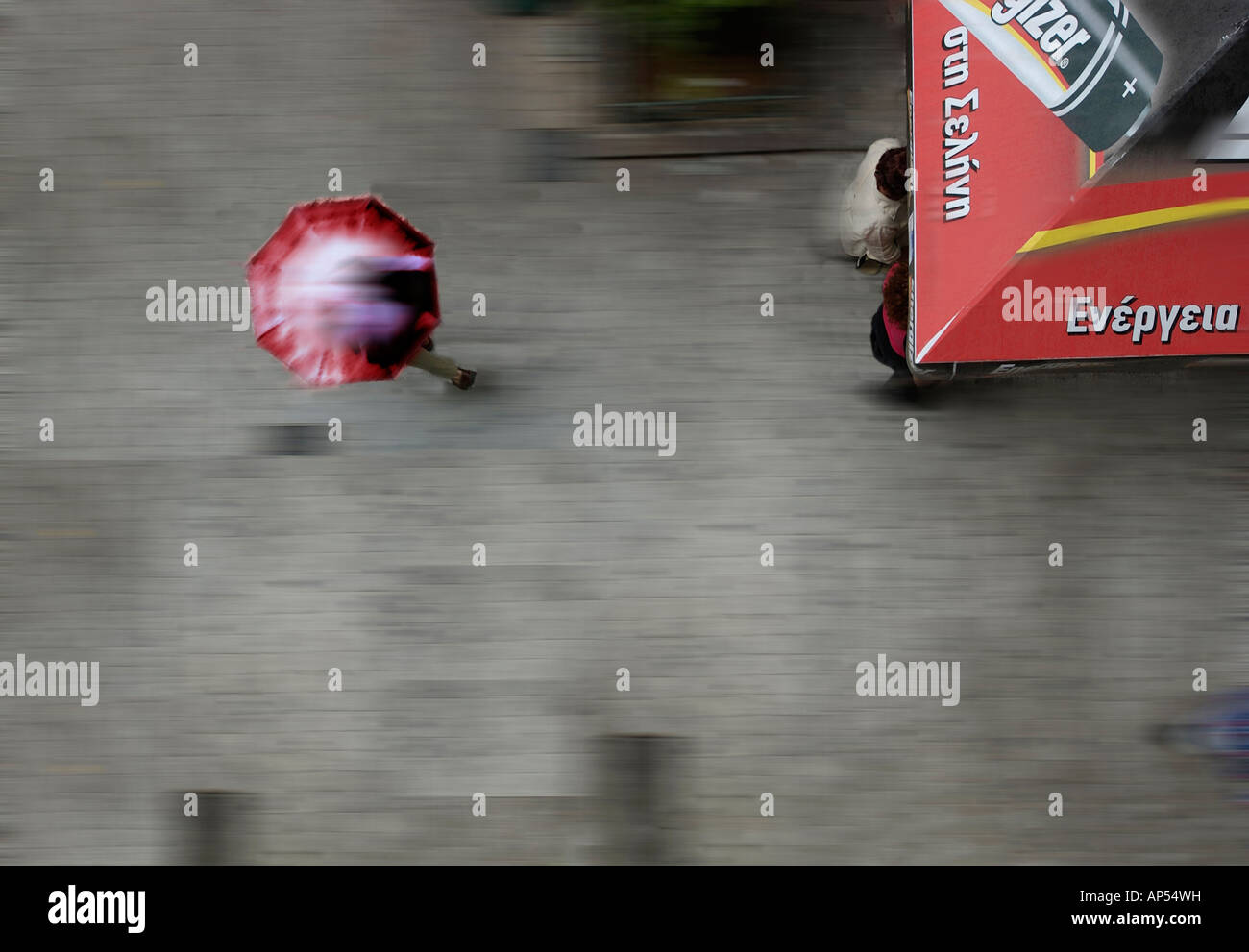Impression of movement & energy in a top view of a street in Athens in the rain. Periptero - kiosk, shows part - Stock Image