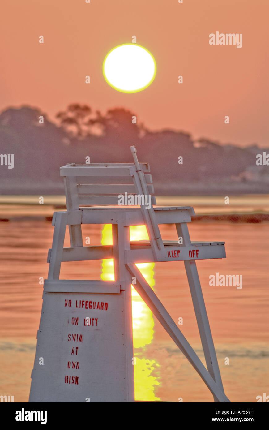 Sun Rising Over Lifeguard Chair, Compo Beach, Westport, Ct. USA.