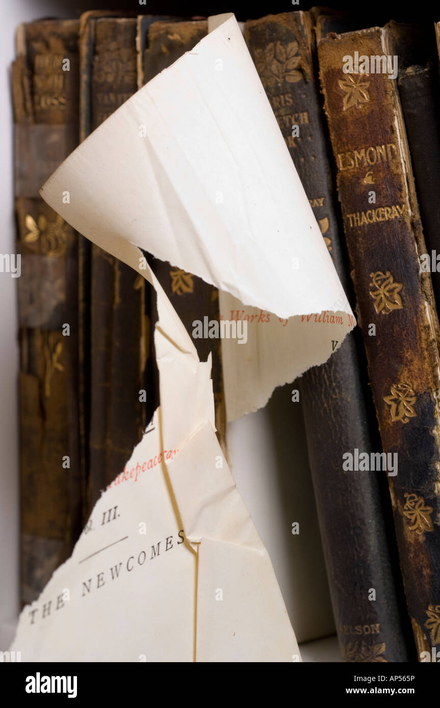 Antique book with torn page. - Stock Image