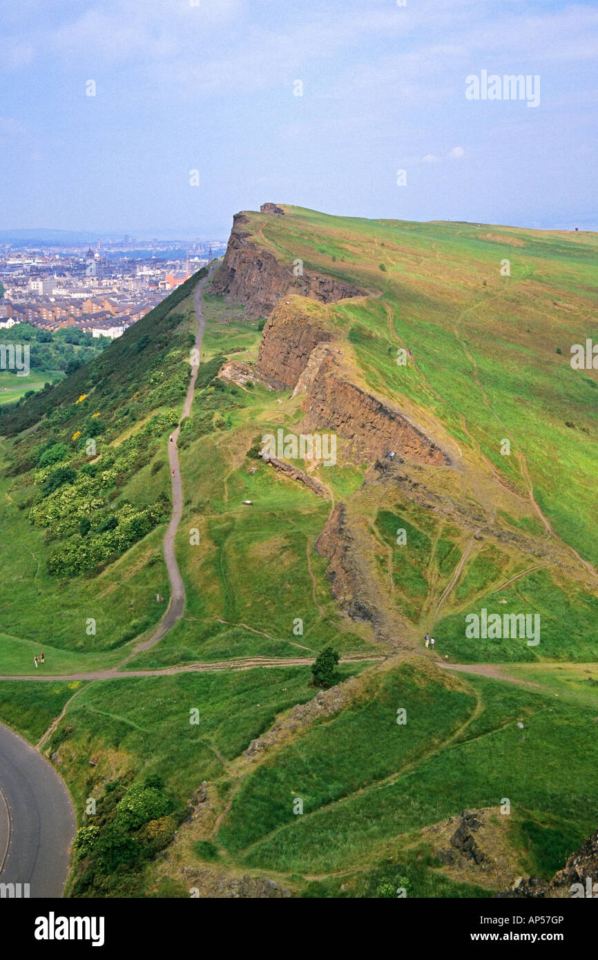 Walkers on Salisbury Crags and the Radical Road in Holyrood Park Edinburgh - Stock Image
