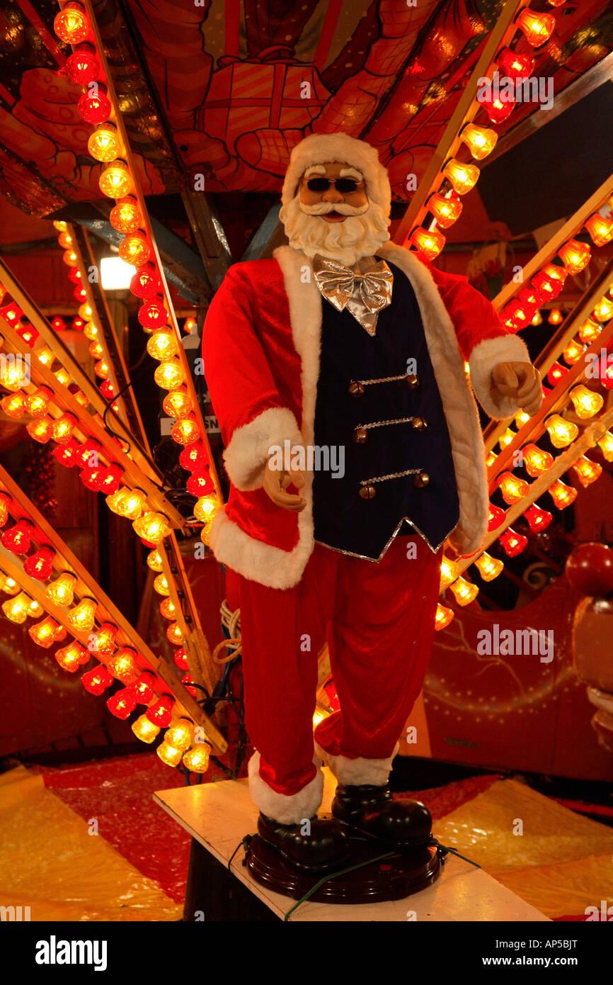 Christmas plastic Santa Claus at a fun fair, Cardiff Winter Wonderland, Cathys Park, Cardiff, South Wales, UK. - Stock Image