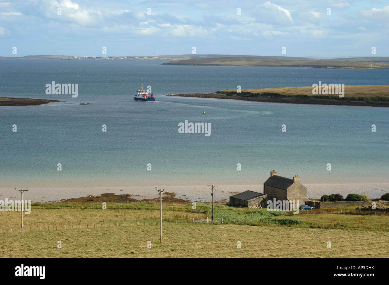 a ferry leaving houton in the bay of houton on orkney mainland stock