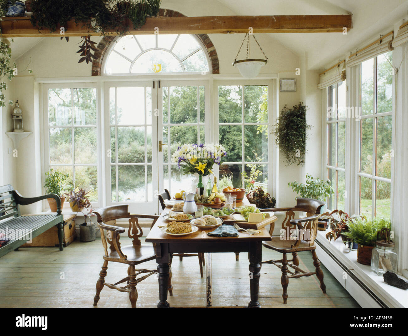 Large Dining Room With Windows Stock Photo Alamy