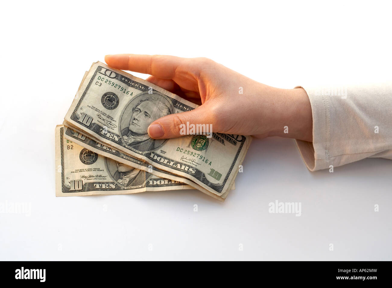 Hand Holding a Fan of ten dollars - Stock Image