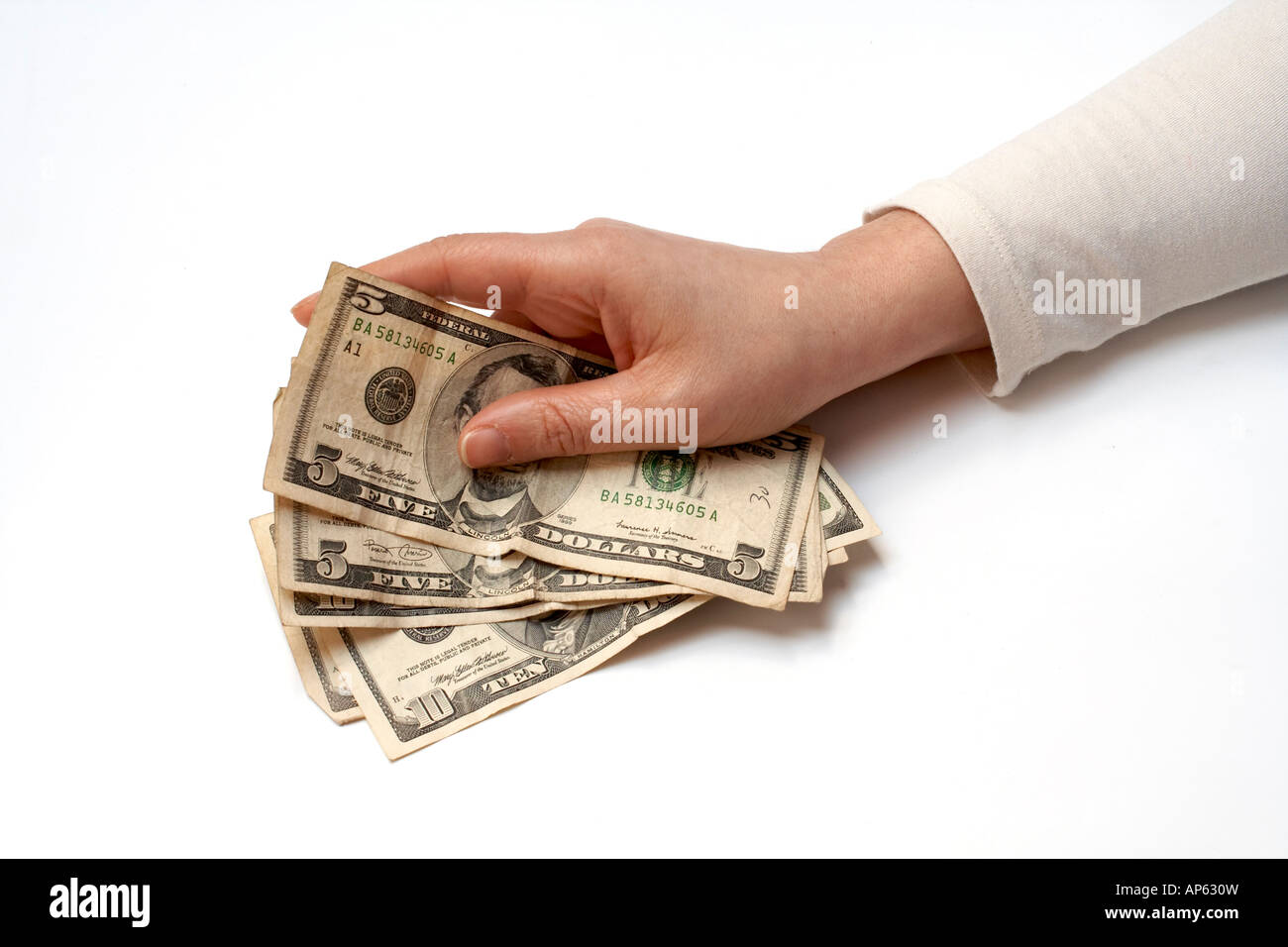 Hand Holding Fan of American Money - Stock Image