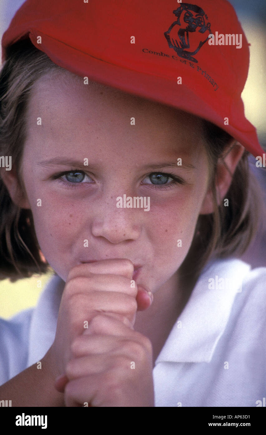 young girl eating at sportsday picnic - Stock Image