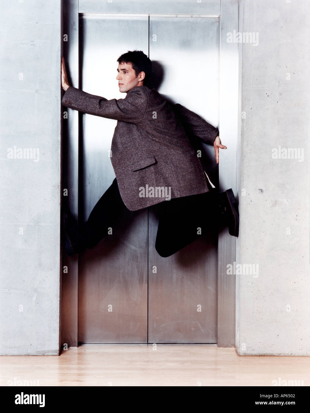 man in elevator door - Stock Image