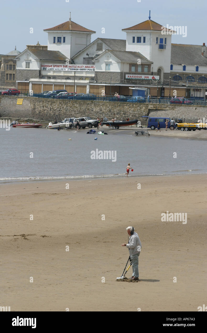 A metal detectorist on the beach at Weston super Mare Stock Photo