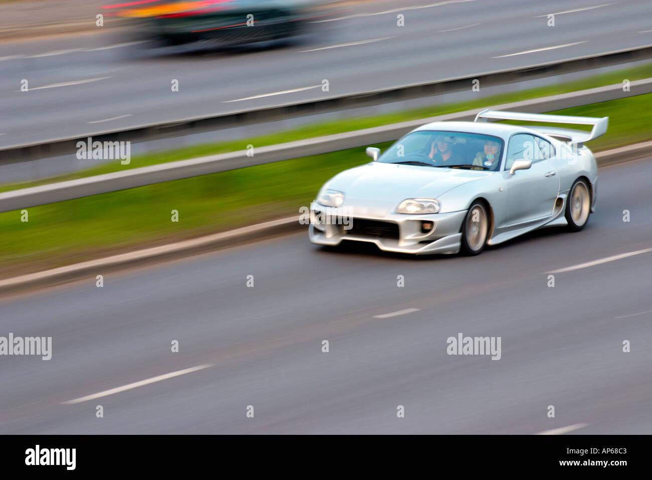 Toyota Supra Sports Car Speeding Fast On Motorway Highway Automobile