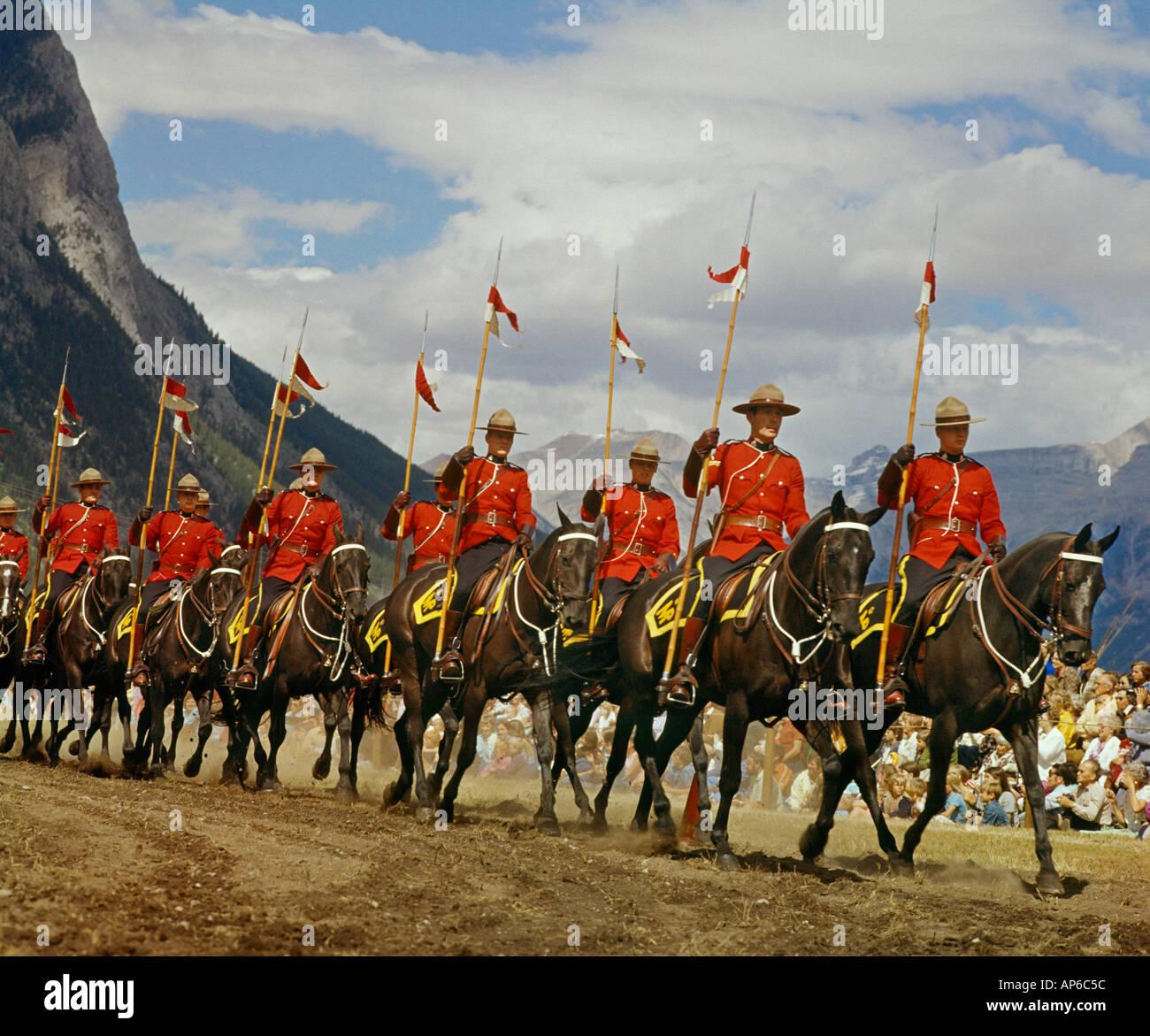 squad of Canadian Mounted Police on horseback with lances - Stock Image