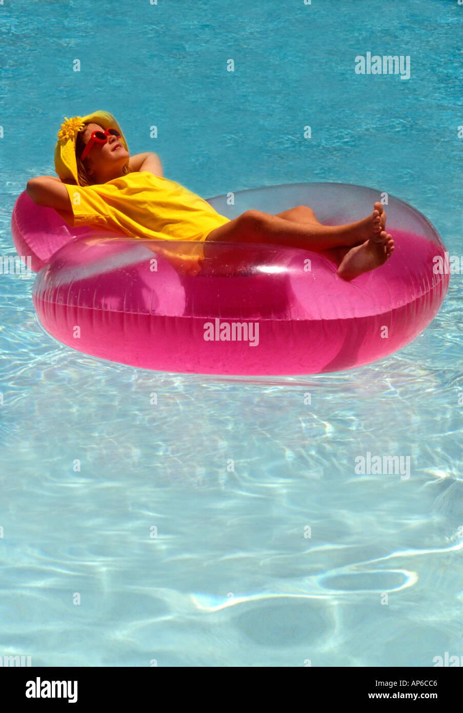 Yellow lilo stock photos yellow lilo stock images alamy - Swimming pool girl christmas vacation ...