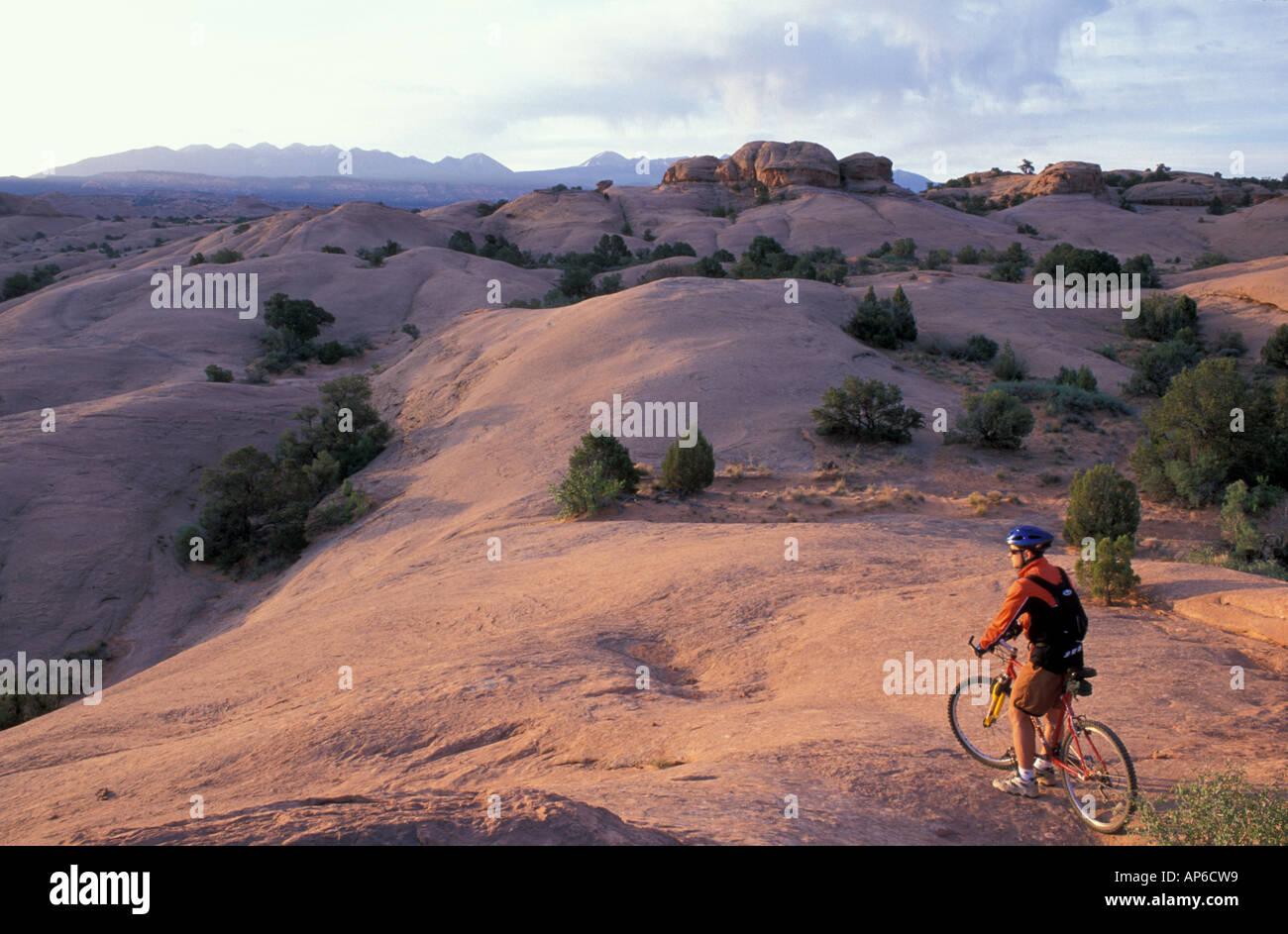 Moab, UT Mountain biking on the Moab Slickrock Bike Trail. Navajo Sandstone. BLM land. Stock Photo