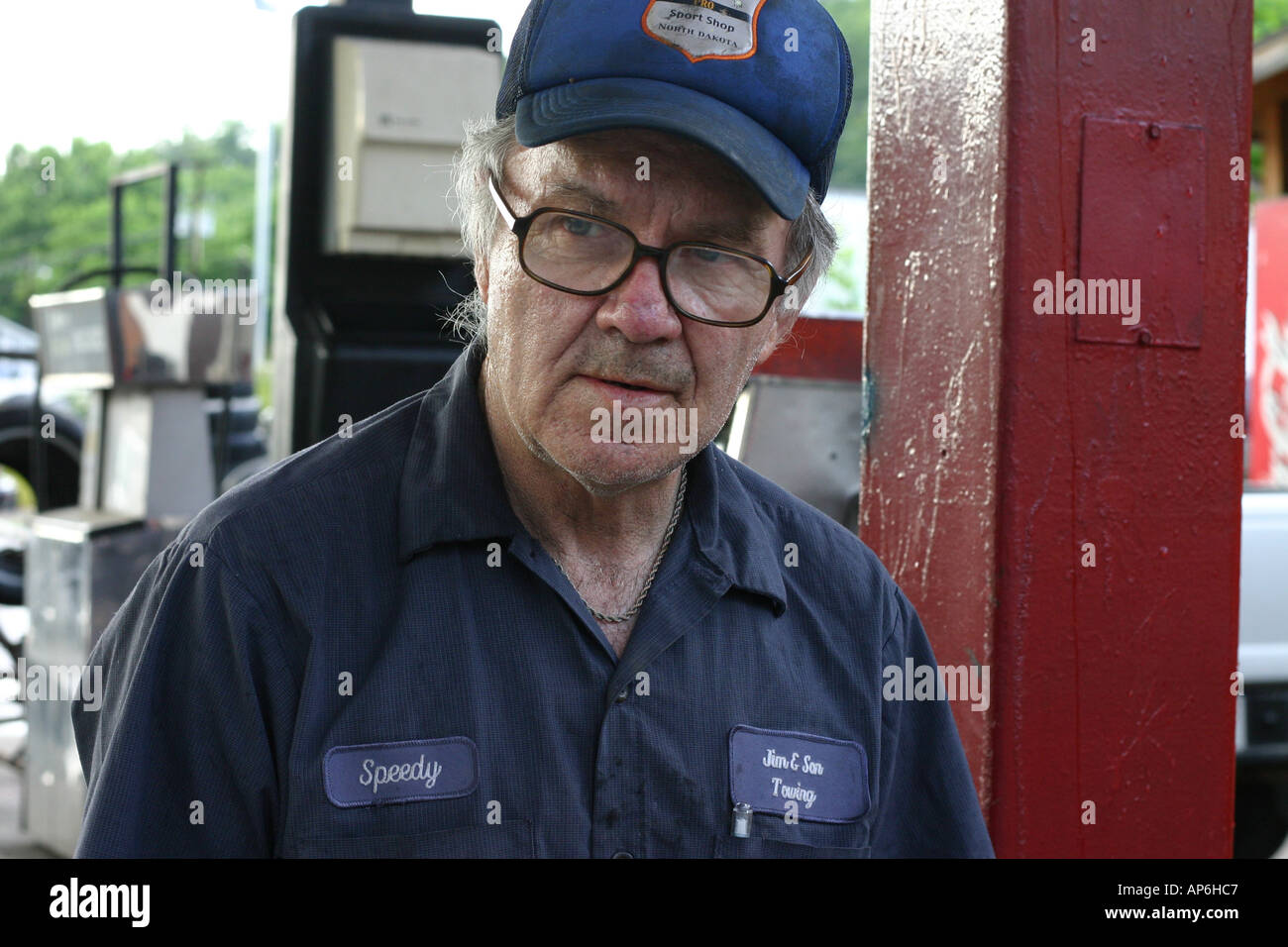 gas station attendant older man with cap and uniform on in north carolina usa