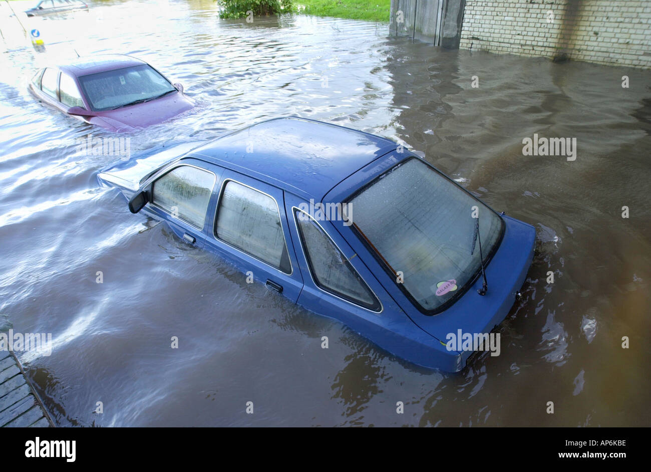 Cars stranded on flooded road after heavy rain in city of Newport South Wales UK - Stock Image