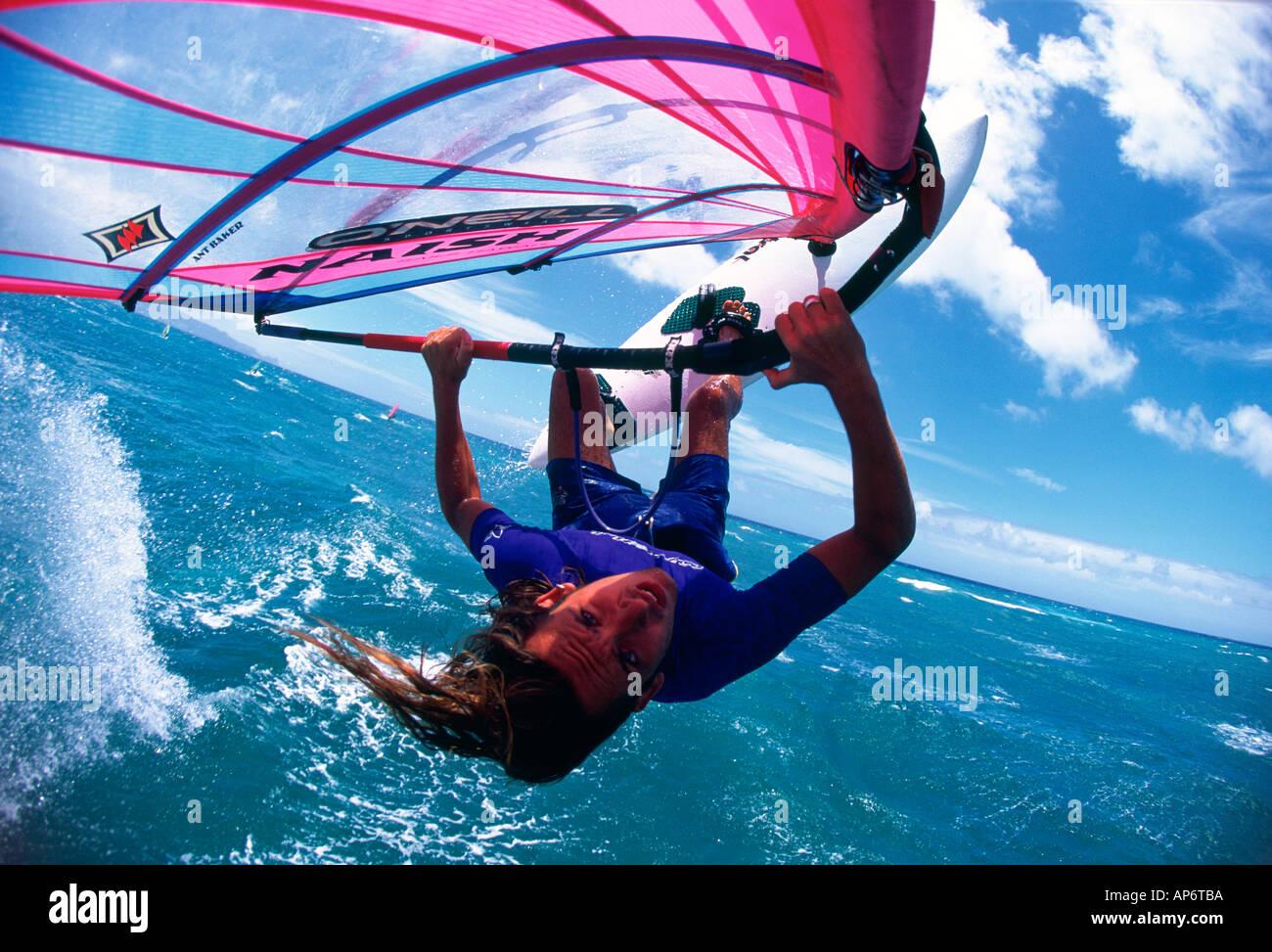 Windsurfer horizontally in the air sail shot jump face sea surf - Stock Image