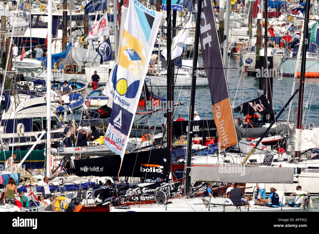 the packed yacht haven harbour port at cowes marinas during cowes week different unusual views showing atmosphere - Stock Image