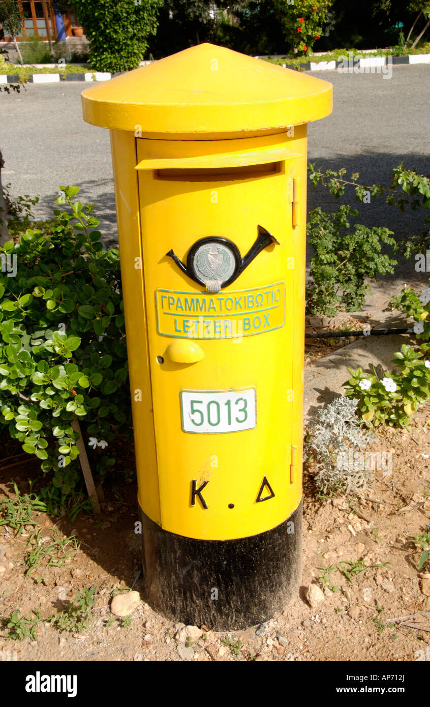 Yellow post box on the Eastern Mediterranean island of Cyprus EU Stock Photo