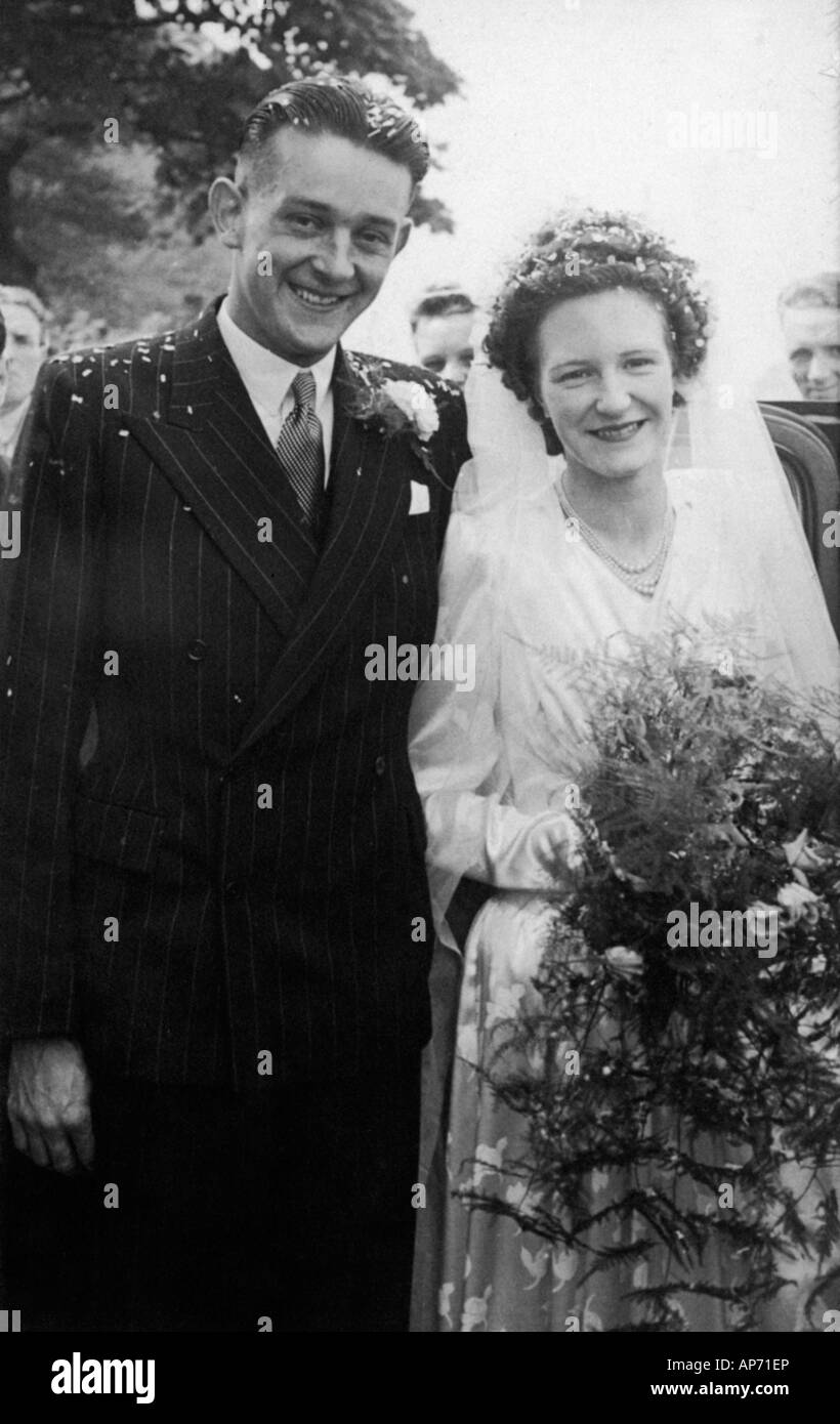 Old Black And White Family Portrait Snap Shot Of Bride And Groom On