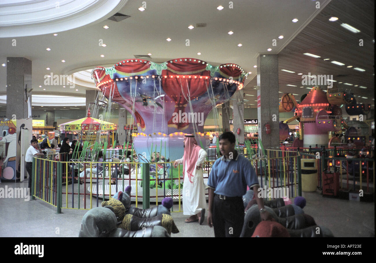 Arabian families in amusement center in a shopping mall in Jeddah - Stock Image