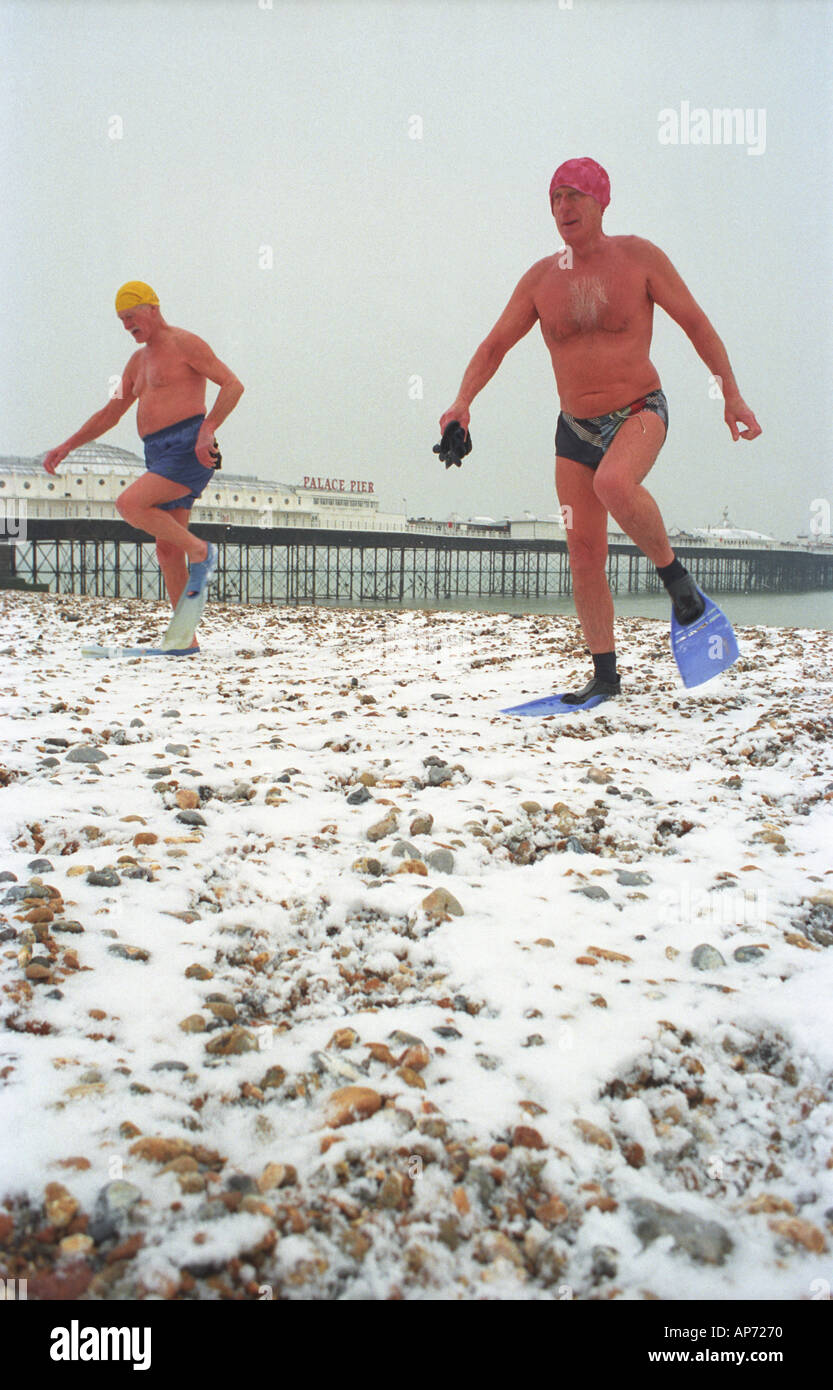 Winter swimmers in Brighton England - Stock Image