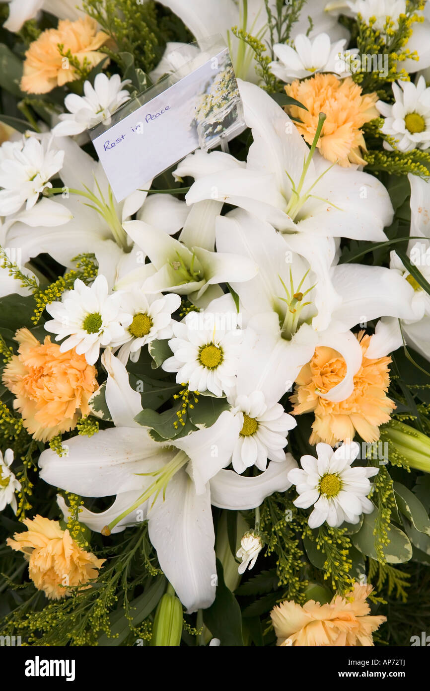 Lilly In Mixed Flowers Funeral Wreath With Rest In Peace Card Uk