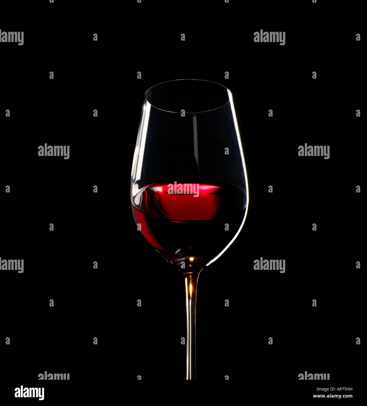 Red Wine in Glass showing the subtle hues of the ageing process - Stock Image