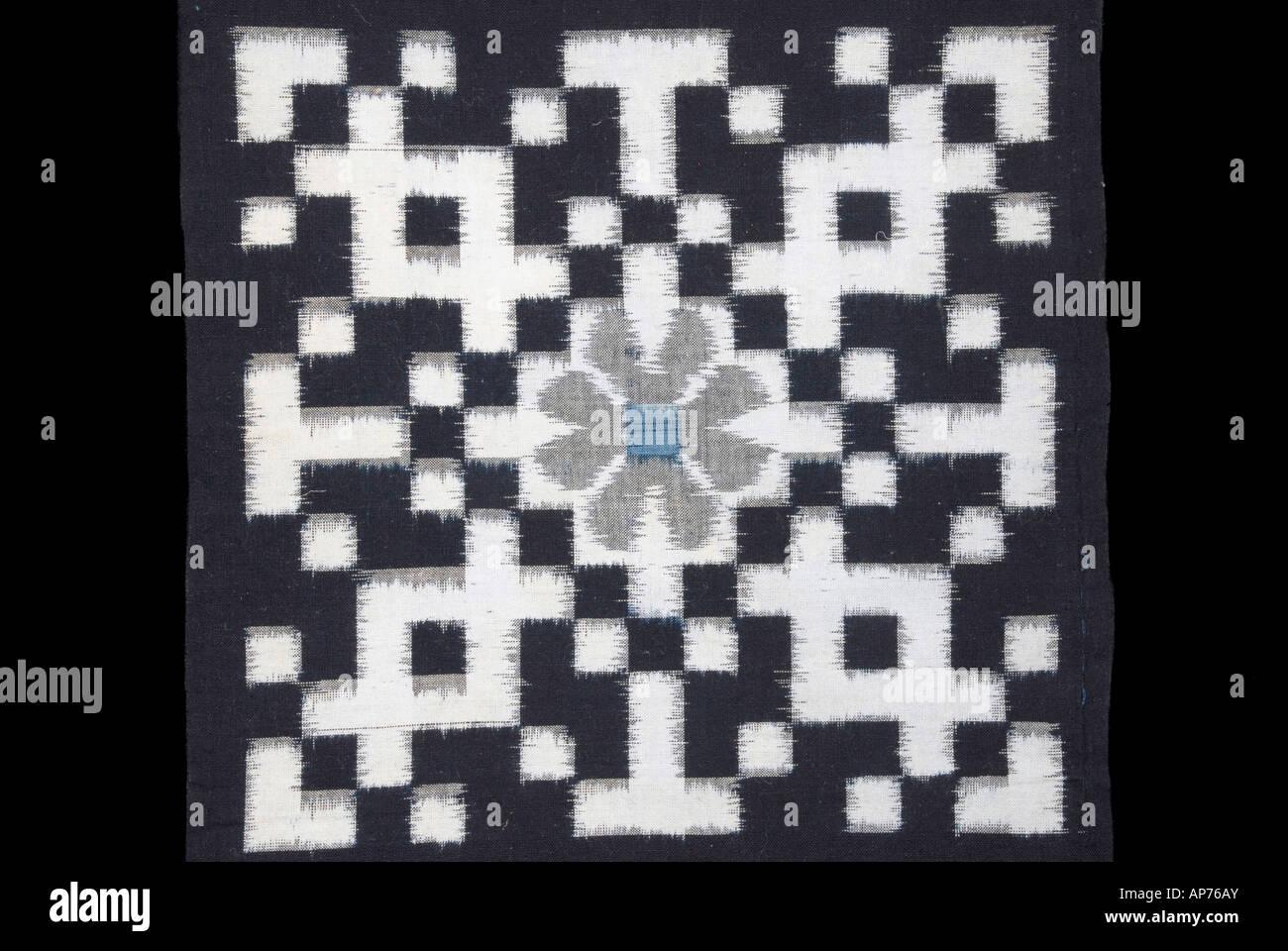 Detail of an indigo dyed ikat kasuri fabric from Japan - Stock Image