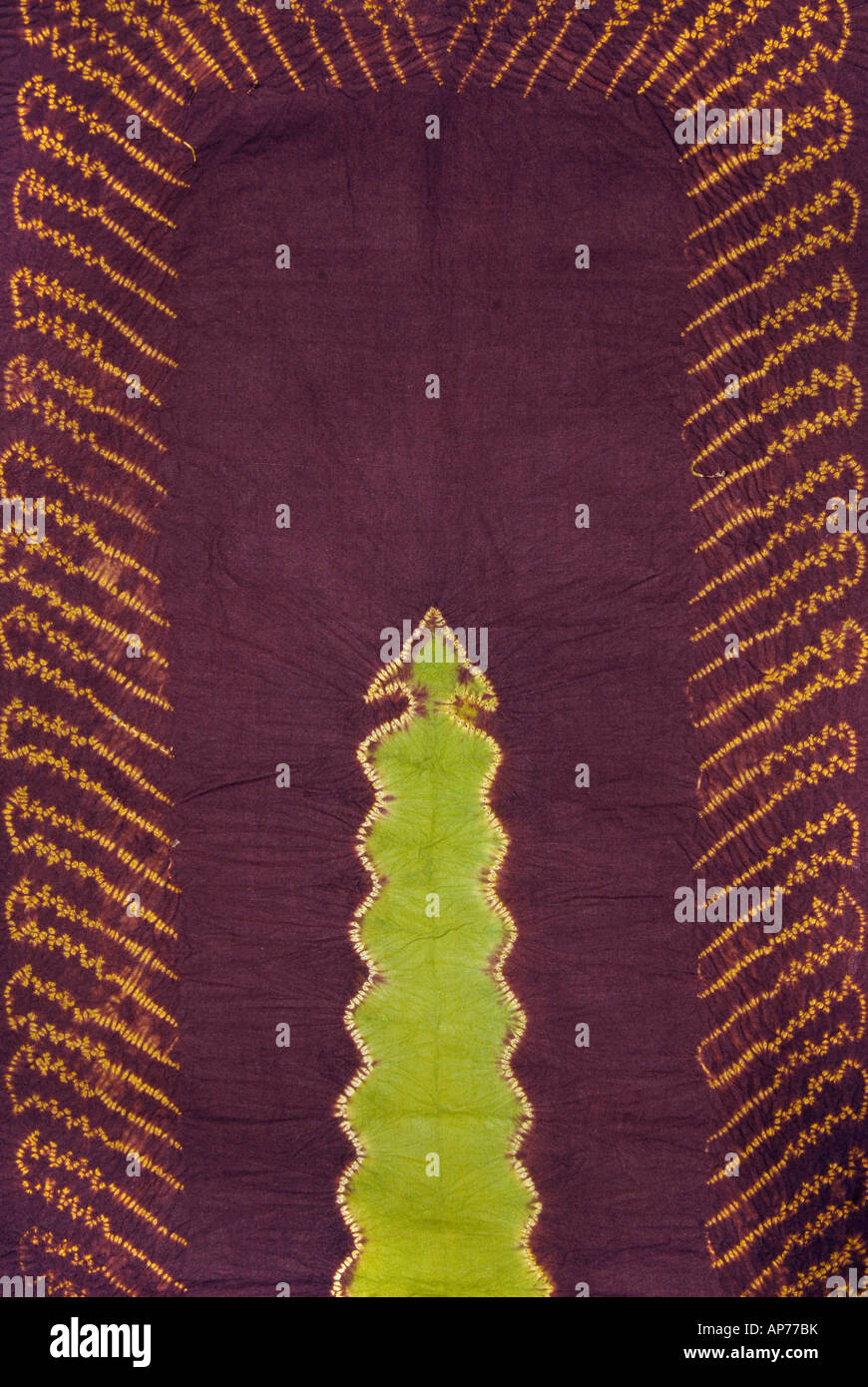 Detail of plangi and tritik resist dyed silk fabric from Sumatra Indonesia - Stock Image