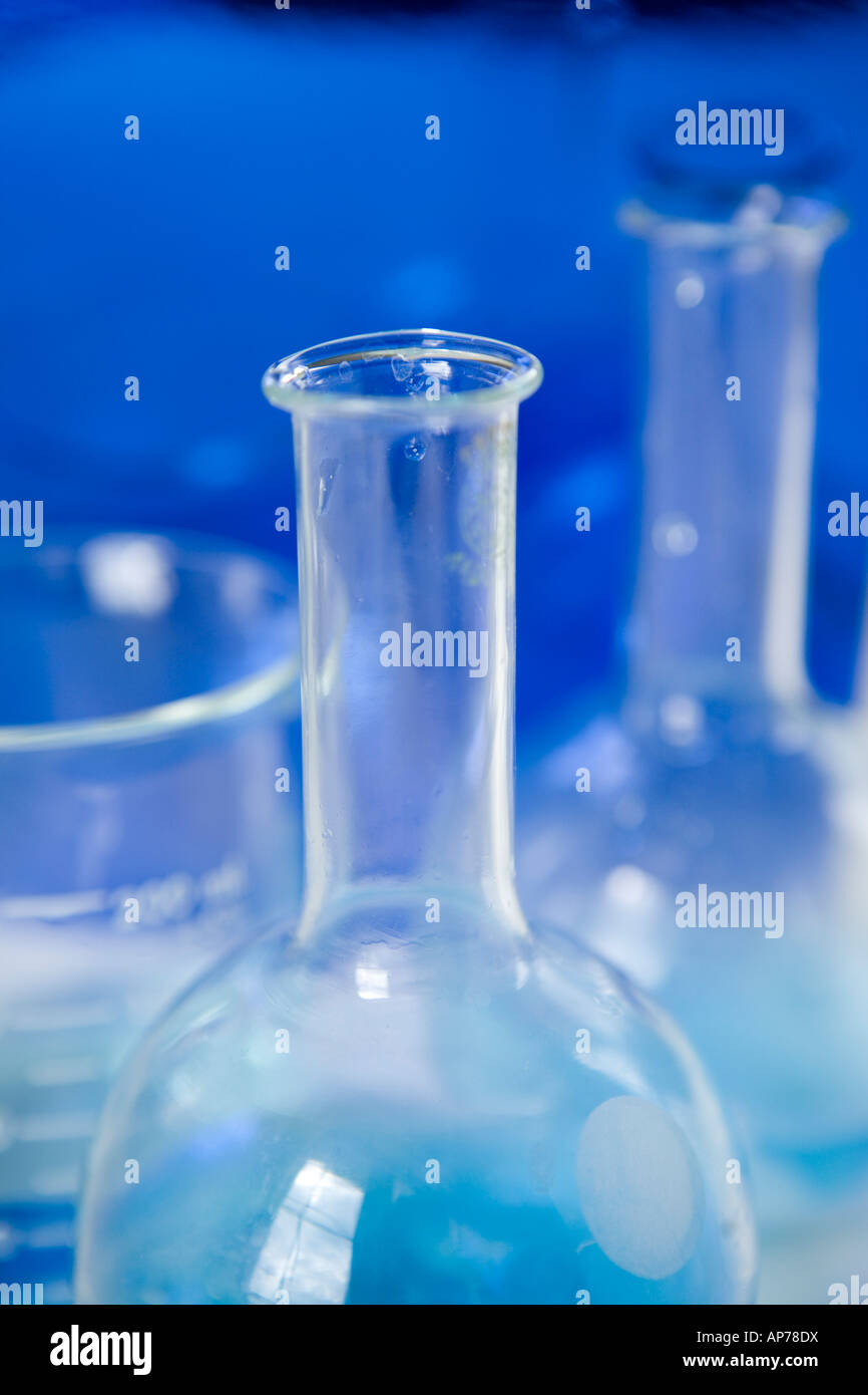 science research chemistry flasks and beakers with blue solution in laboratory research biotech chemistry beaker - Stock Image