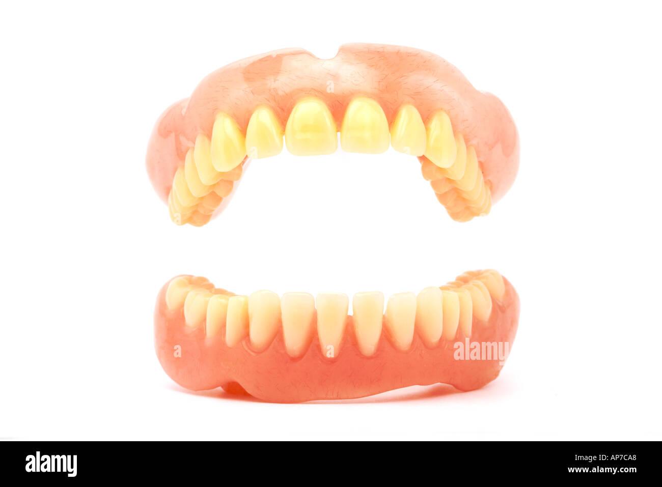 False Teeth open mouth  - Stock Image