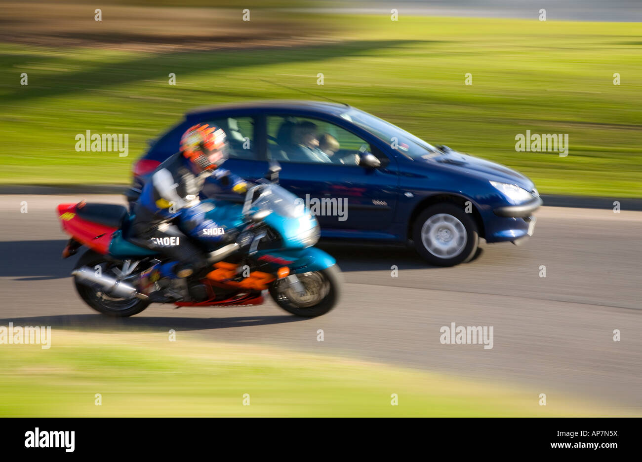 Moving car and motor bike on roundabout, Dundee, Tayside, Scotland, UK - Stock Photo