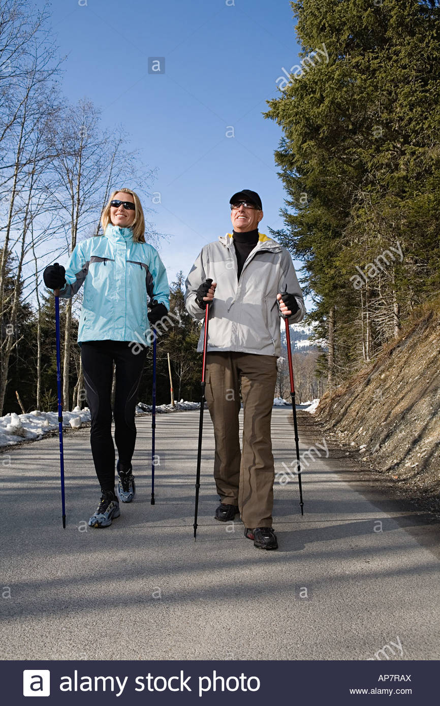 Couple walking with poles - Stock Image