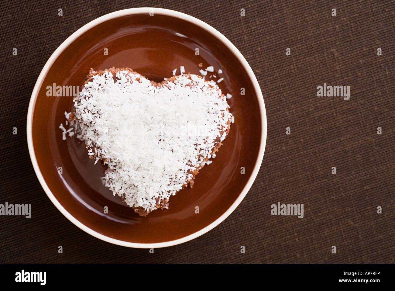 A cake decorated in desiccated coconut - Stock Image