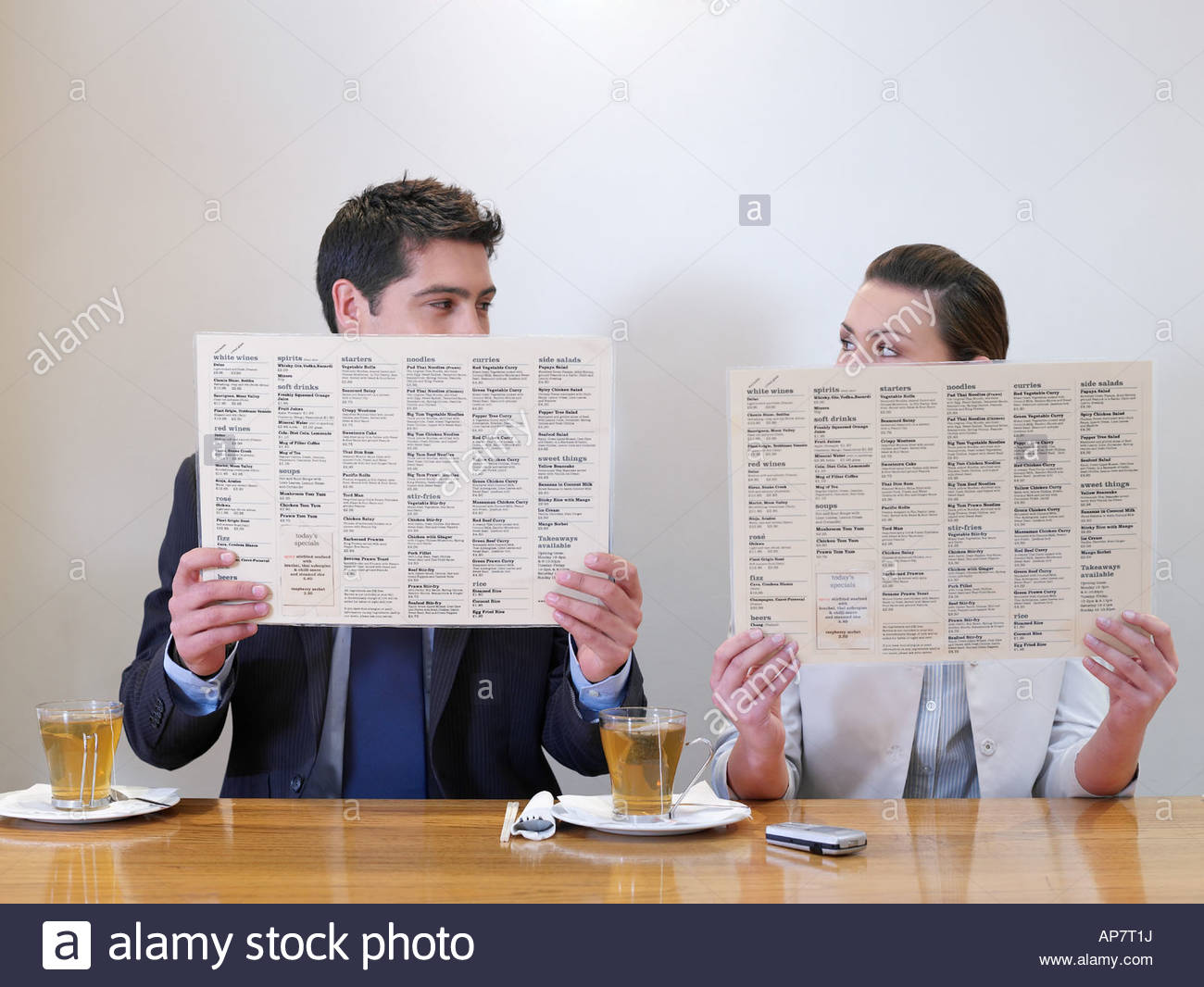 Man and woman with menus - Stock Image