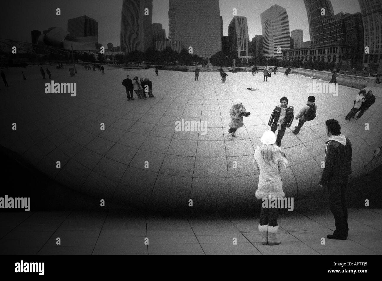 A couple looking at each other s reflections in the bean sculpture in millenium park in chicago downtown p keywords chicago mill · rwi fine art photography