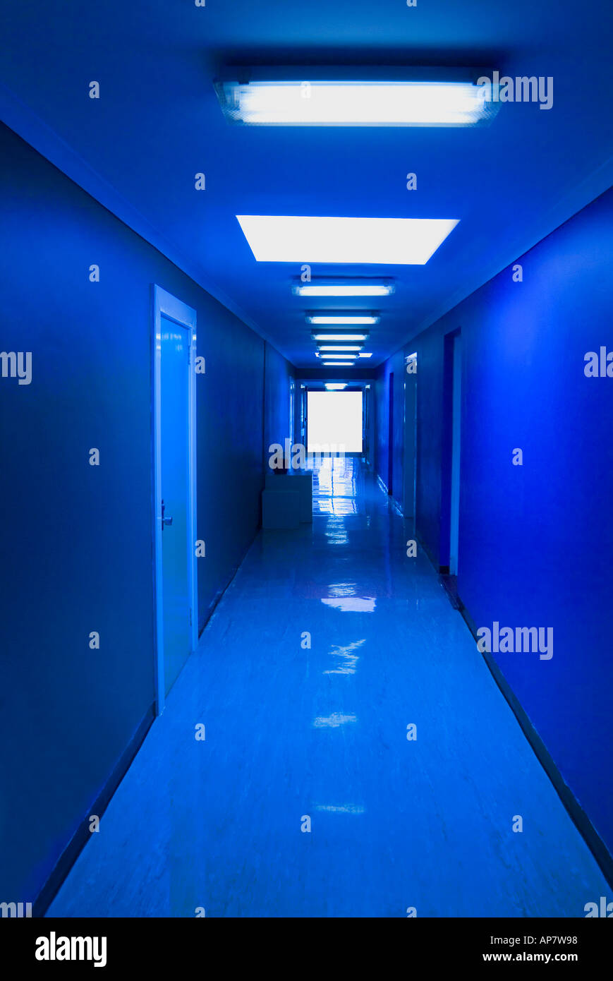 Mysterious blue hallway terminating in a void - Stock Image