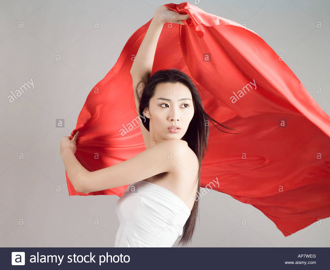 Chinese woman holding a red flag - Stock Image