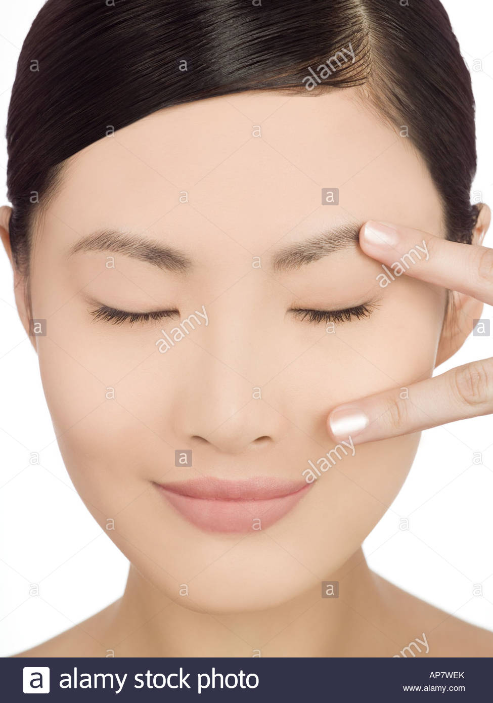 Serene looking chinese woman - Stock Image