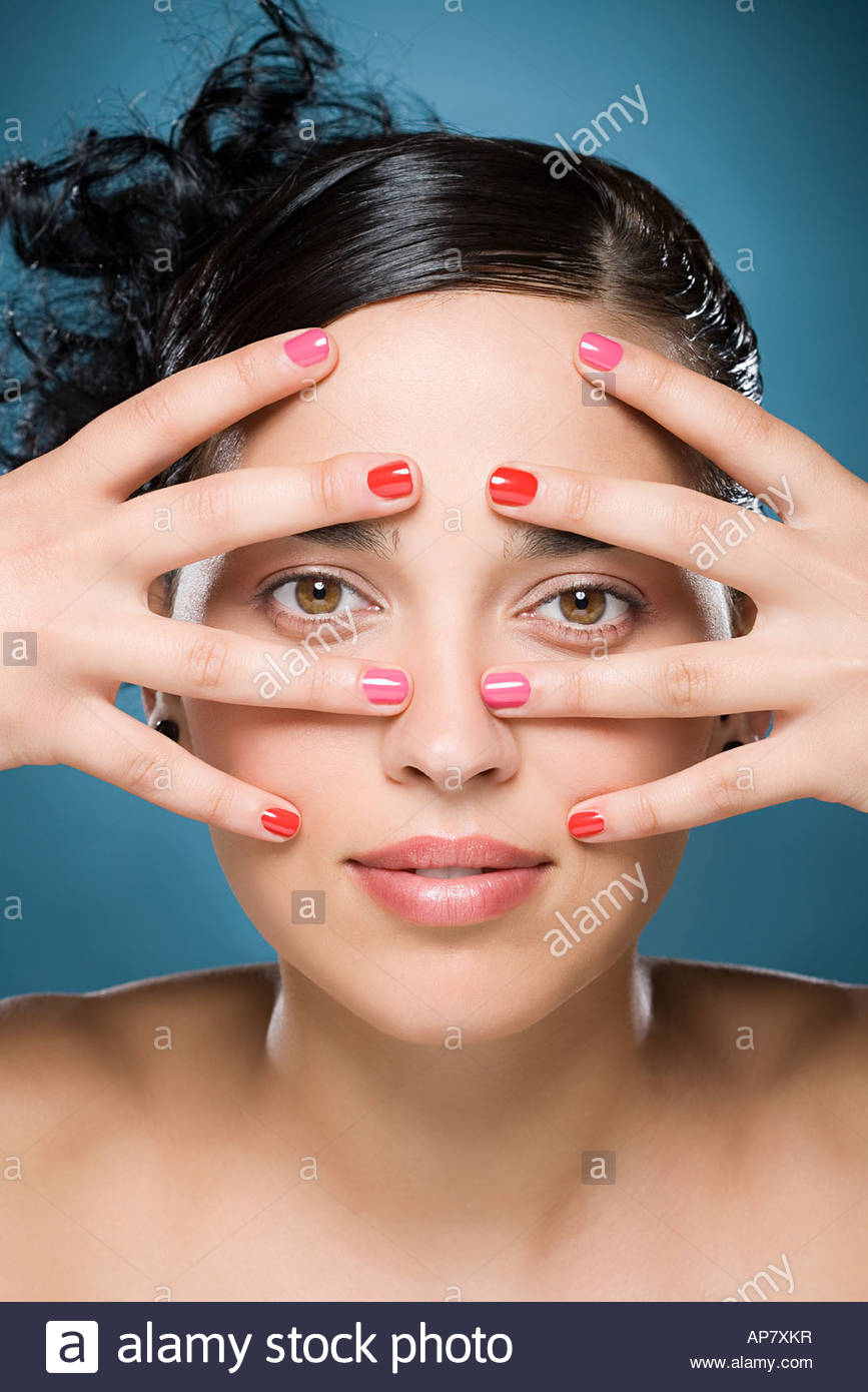 Woman with hands on her face - Stock Image