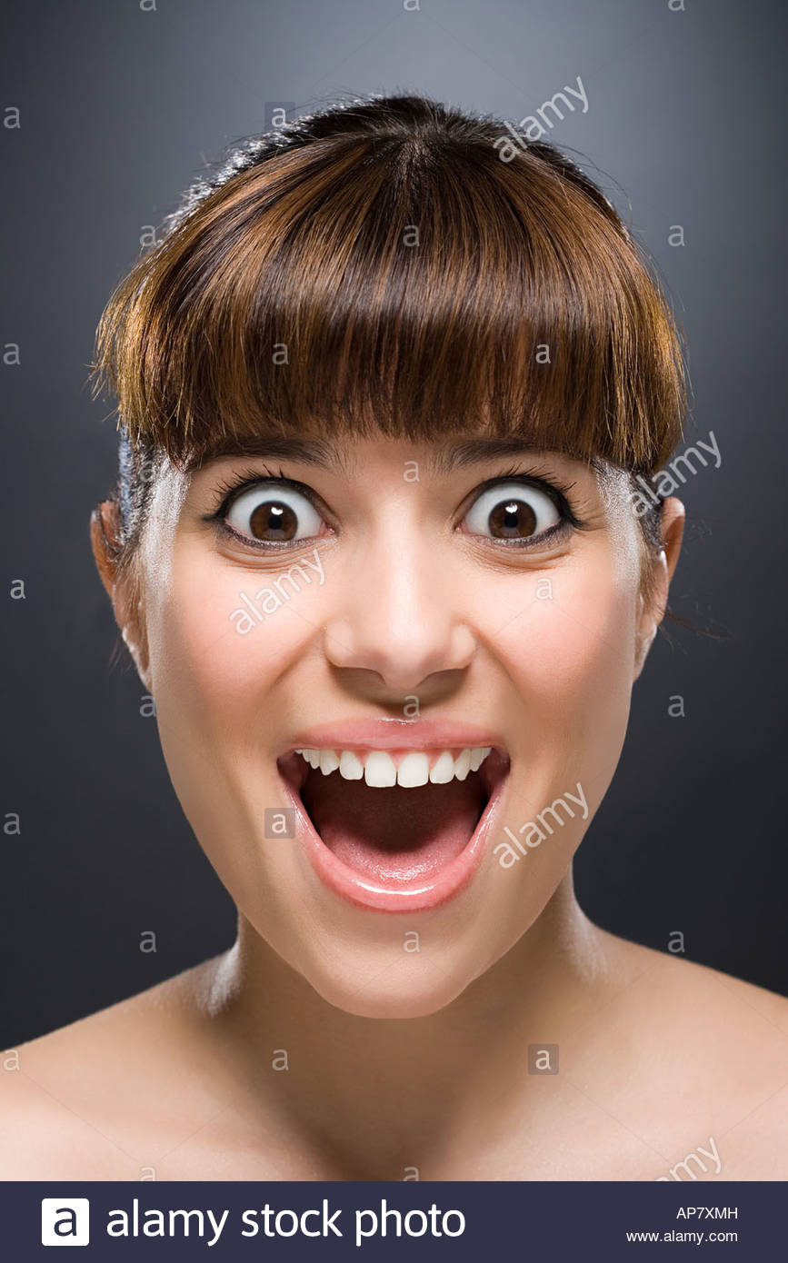 Woman with eyes wide open - Stock Image