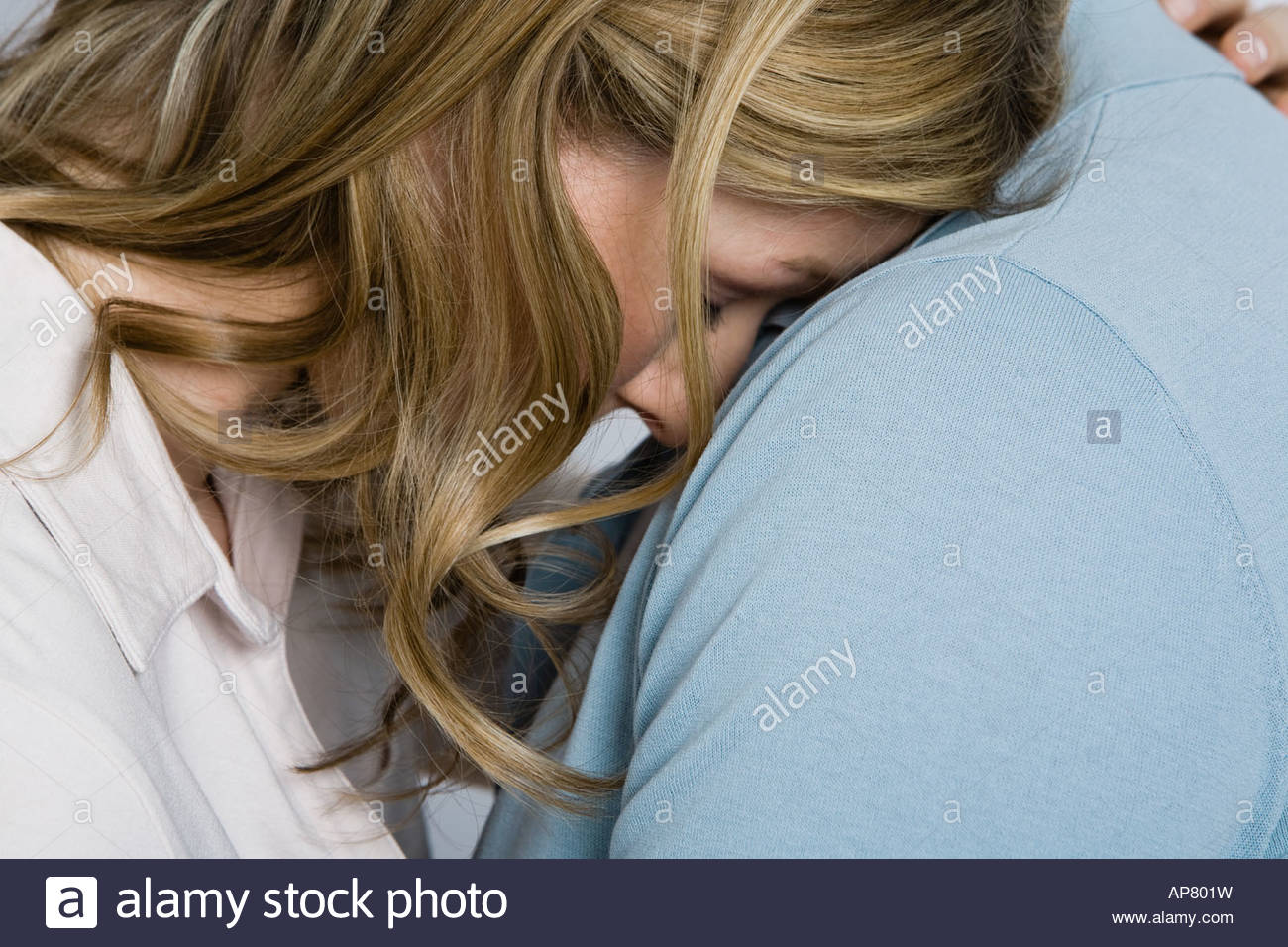 Woman being consoled - Stock Image