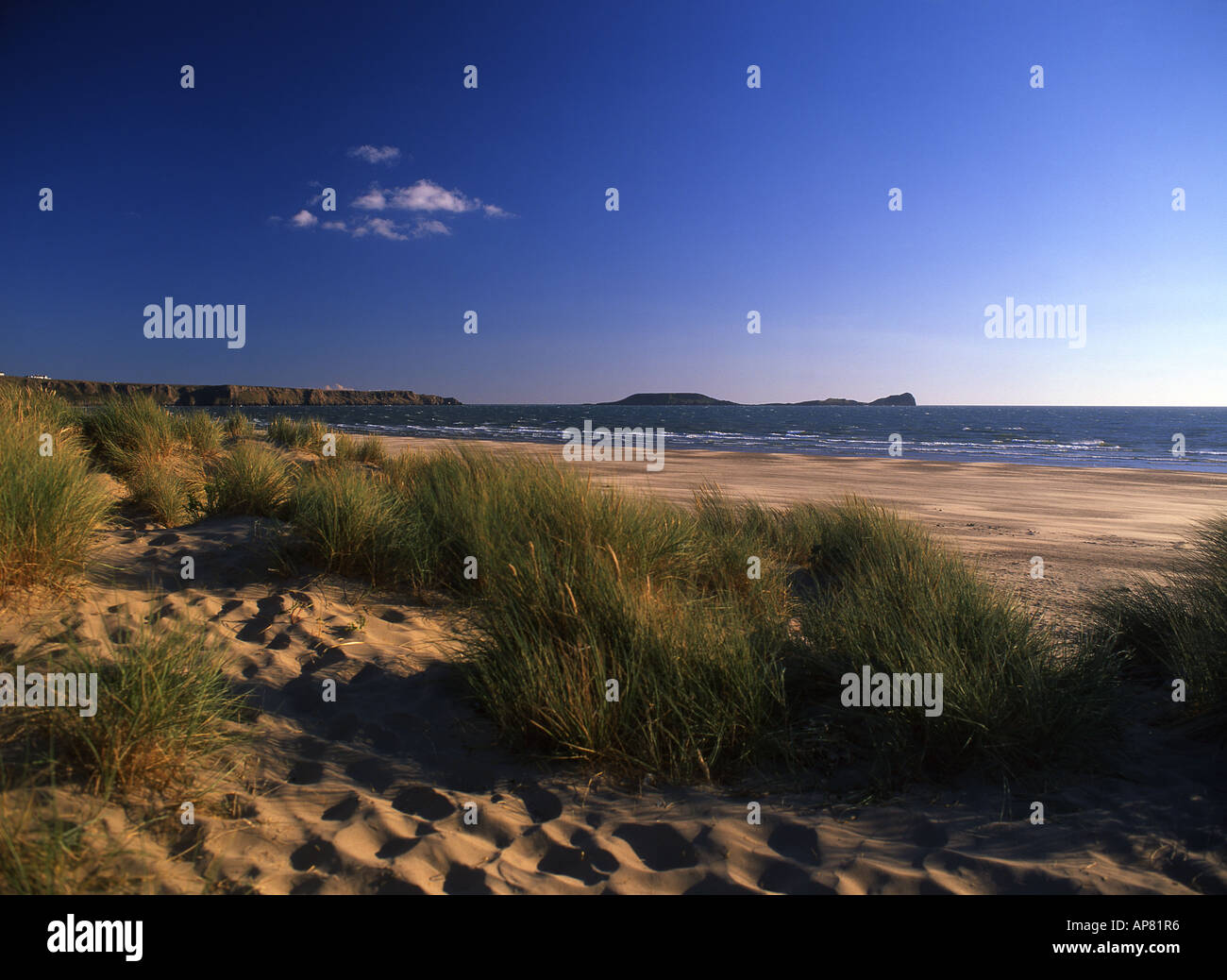 Worm's Head from Llangennith end of Rhossili beach Gower Peninsula Swansea South Wales UK - Stock Image