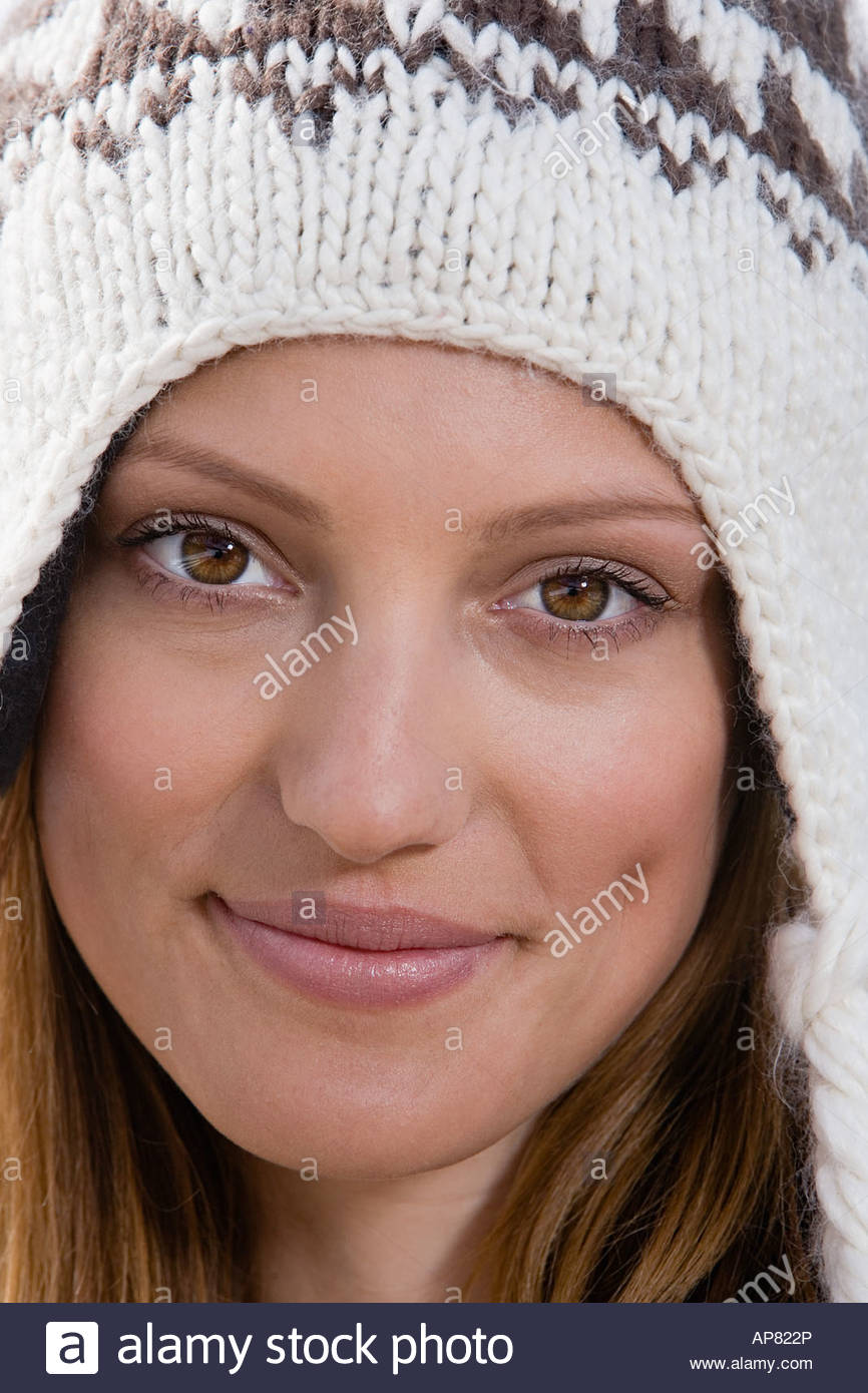 Woman wearing a knit hat - Stock Image