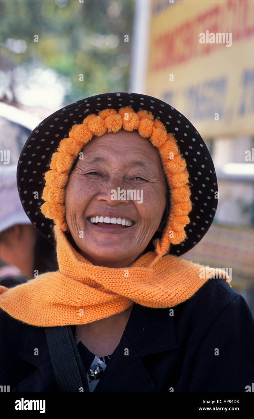 Friendly woman with hat and scarf at street market opposite central bus terminal Vientiane Laos - Stock Image