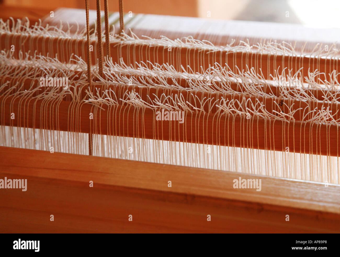 Warp knots on a weavers loom - Stock Image